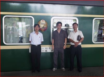 Me with our two guides in front of the train bount for Beijing.